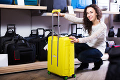 Woman choosing suitcase in shop Stock Images