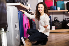 Woman choosing suitcase in shop Stock Photography