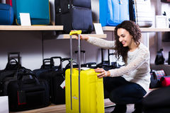 Woman choosing suitcase in shop Royalty Free Stock Photo