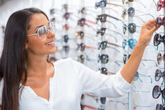 Woman choosing sunglasses. Stock Photos