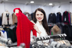 Woman choosing sweater at clothing store Royalty Free Stock Photos