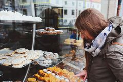 Woman choosing sweet cakes at street cafe in Portugal. Woman choosing sweet cakes at street cafe royalty free stock image