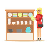 Woman Choosing Tableware, Smiling Shopper In Furniture Shop Shopping For House Decor Elements. Cartoon Character Looking For Home Interior Design Items In Royalty Free Stock Photos