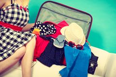 Woman choosing things to pack into suitcase royalty free stock photos