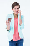 Woman choosing to eat chocolate or not Stock Photography