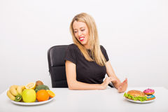 Woman choosing to eat healthy royalty free stock image