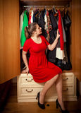 Woman choosing what clothes to wear at wardrobe Royalty Free Stock Photos