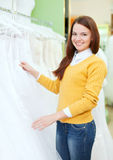 Woman  choosing white dress at shop Royalty Free Stock Image