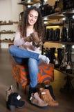 Woman choosing winter women shoes Stock Image
