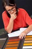 Woman choosing wood color royalty free stock photo