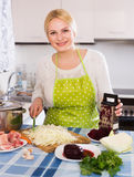 Woman chopping cabbage for soup Royalty Free Stock Photography