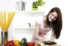 Woman chopping cucumber Stock Image