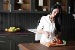 Woman chopping fresh vegetbles Royalty Free Stock Photo
