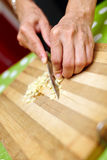 Woman chopping garlic Stock Photo