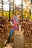 Woman chopping and splitting wood Stock Photo