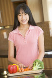 Woman Chopping Vegetables. Smiling To Camera Stock Image