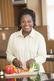 Woman Chopping Vegetables Stock Photo