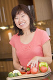 Woman Chopping Vegetables. In Kitchen Stock Photo