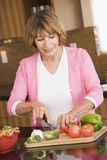 Woman Chopping Vegetables. In Kitchen Royalty Free Stock Image