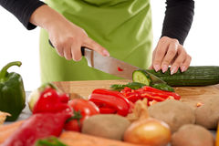 Woman chopping vegetables Royalty Free Stock Photos