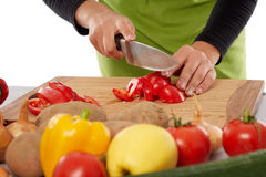 Woman chopping vegetables Royalty Free Stock Photo