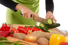 Woman chopping vegetables Stock Photos