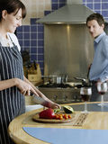 Woman Chopping Vegetables In Kitchen stock image