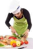 Woman chopping vegetables Stock Photos