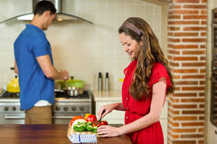 Woman chopping vegetables and man cooking on stove Stock Images