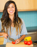 Woman chopping vegitables, preparing healthy dinner Royalty Free Stock Photography