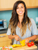 Woman chopping vegitables, preparing healthy dinner Royalty Free Stock Photos