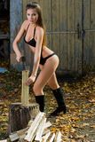 Woman chopping wood. lumberjack Stock Photography