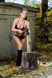Woman chopping wood. lumberjack Royalty Free Stock Images
