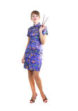 Woman with chopsticks. Young woman in Chinese dress with chopsticks in hands Stock Photography