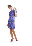 Woman with chopsticks. Young woman in Chinese dress with chopsticks in hands Royalty Free Stock Image