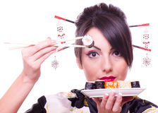 Woman  with chopsticks and sushi Stock Photo