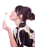 Woman  with chopsticks and sushi Royalty Free Stock Photography