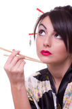 Woman  with chopsticks and sushi Royalty Free Stock Photos