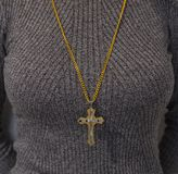 Woman with Christian cross. Around her neck Stock Image
