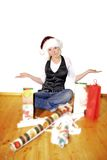Woman on christmas. A happy young woman is wrapping christmas gifts Stock Photography