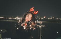 Woman with Christmas antlers Stock Photography