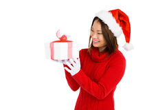 Woman in christmas attire holding gift Stock Image