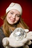 Woman and christmas ball Stock Images