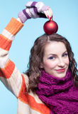 Woman with Christmas ball Stock Images
