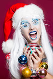 Woman with christmas balls Stock Images