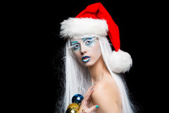 Woman with christmas balls Royalty Free Stock Image