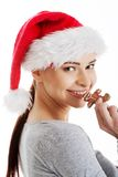 Woman with a christmas biscuit Royalty Free Stock Image