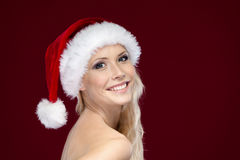 Woman in Christmas cap Stock Photography