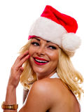 Woman in Christmas cap. A attractive blonde is wearing a Christmas cap stock photo