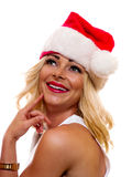Woman in Christmas Cap. A attractive woman is wearing a Christmas cap royalty free stock images